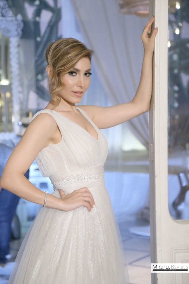 570ba9935bf1d يارا ترتدي فستان الزفاف مجدداً ... شاهدوا فرحها وكواليس الفيديو كليب ...